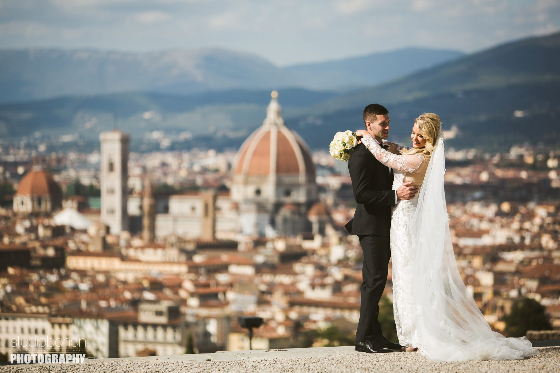 Elegant bride and groom at San Miniato near Piazzale Michelangelo, Florence. Destination wedding at Four Seasons Florence