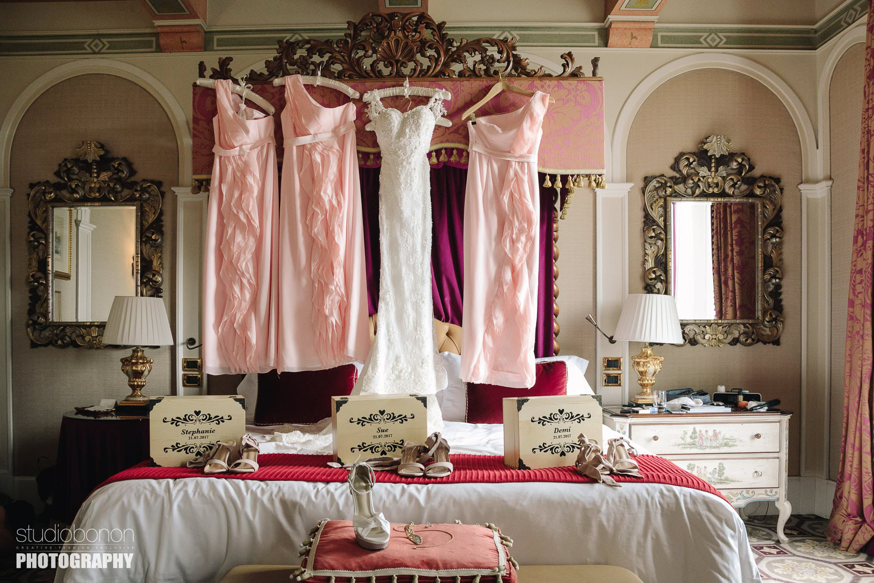White wedding gown and pink bridesmaids dress into luxury St. Regist suite in Florence, Tuscany