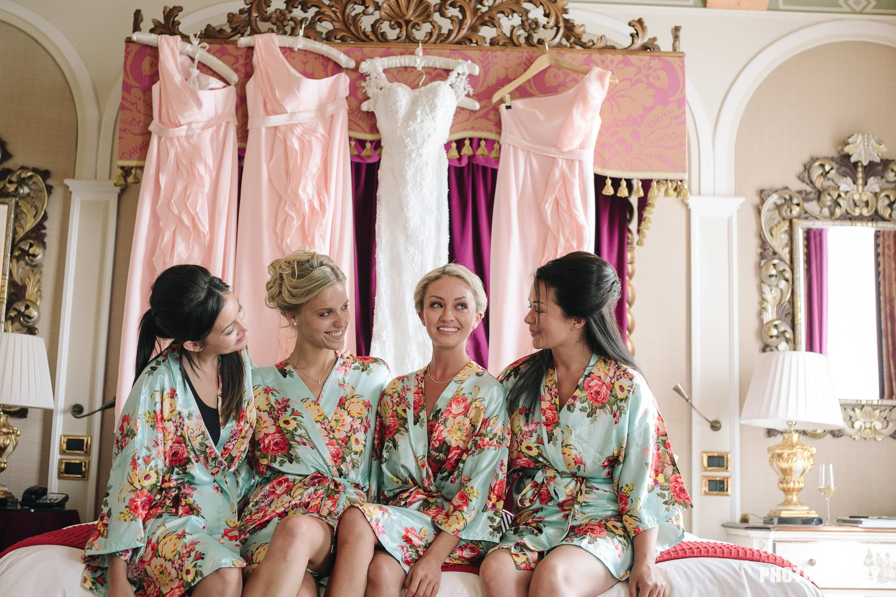 Beautiful bride with bridesmaids in St. Regis suite in Florence. Elegant destination wedding in Tuscany at Vincigliata Castle