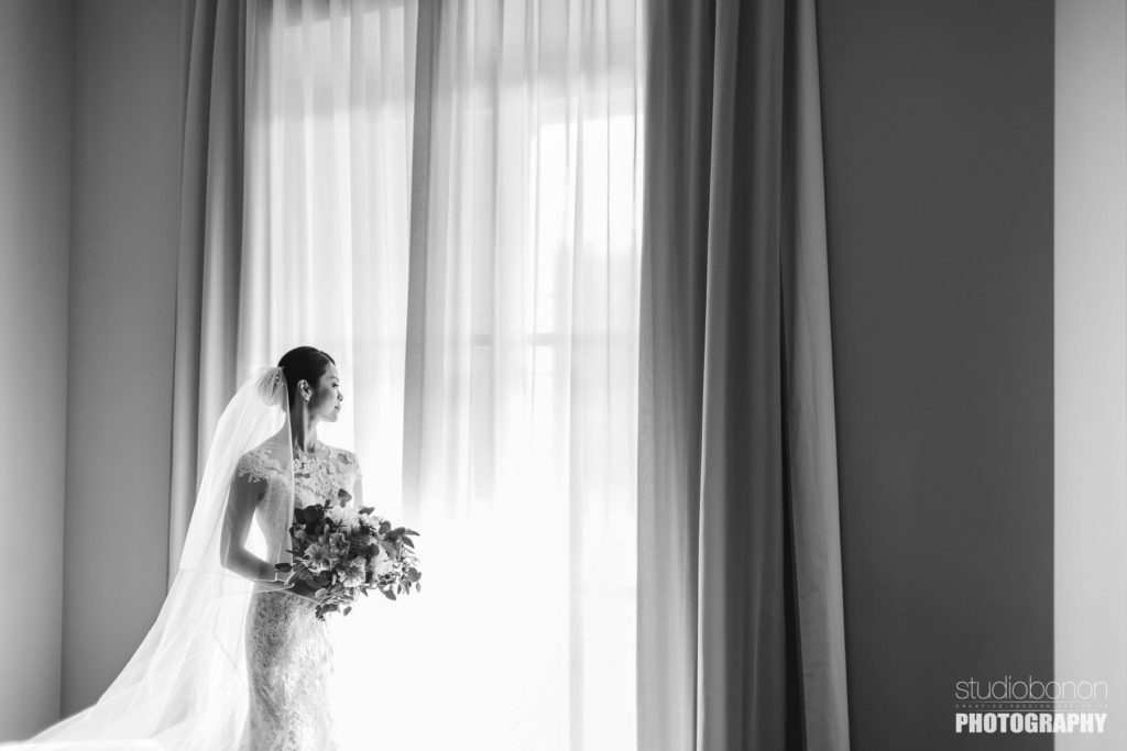Lovely bride at Castelfalfi country resort almost ready to walks down the aisle. Tuscany countryside destination wedding.
