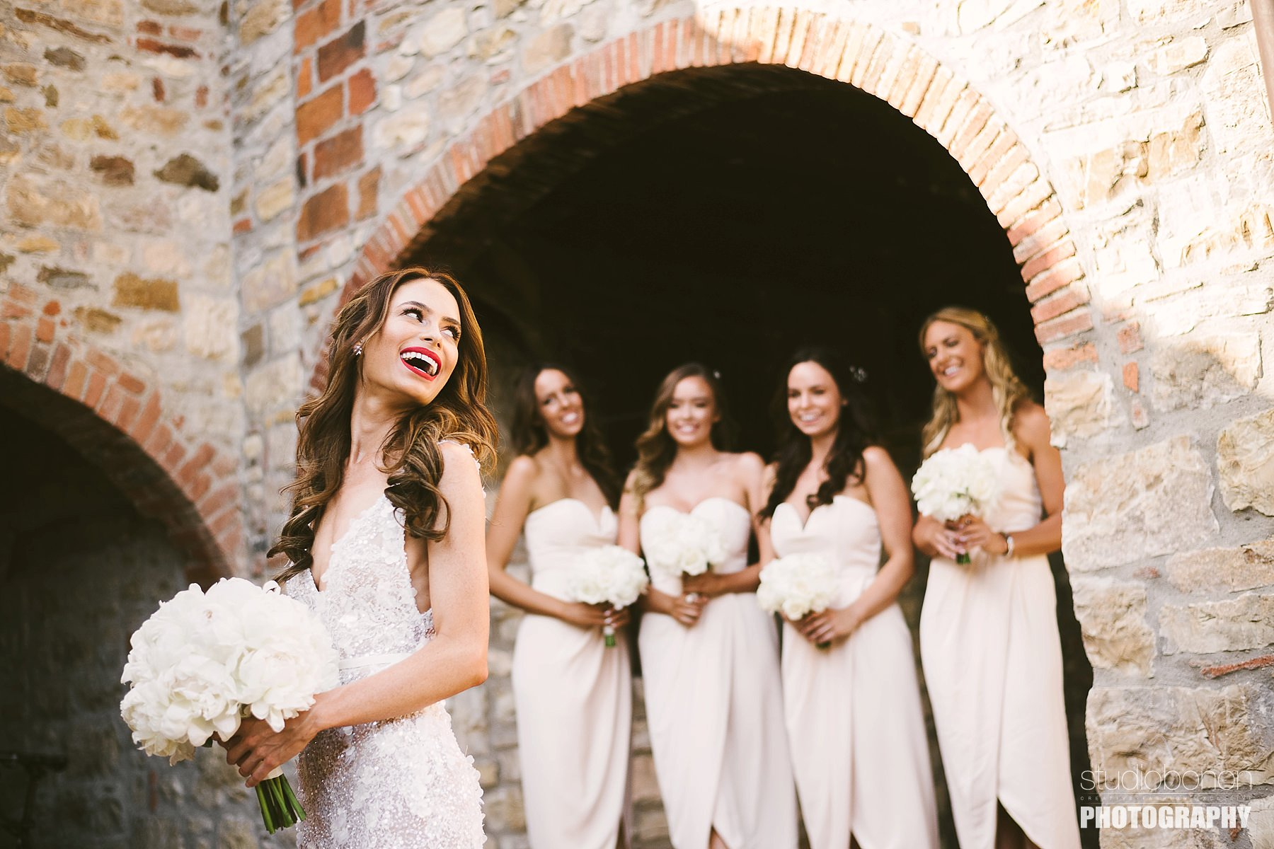 Bride with bridesmaids at Panzano in Chianti. Tuscany countryside destination wedding