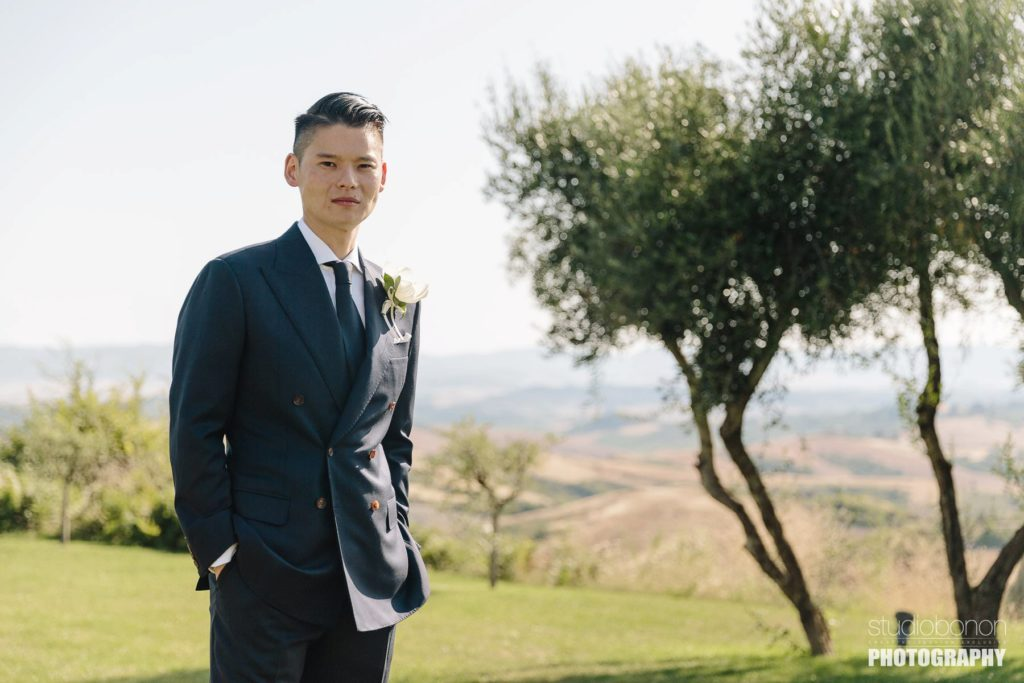 Groom at Castelfalfi country resort for Tuscany countryside destination wedding.
