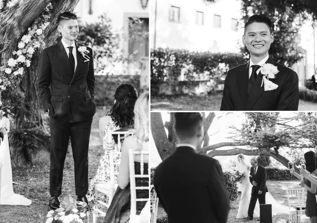 Bride walks down the aisle and groom look at her for the first time. Tenuta di Castelfalfi destination wedding.