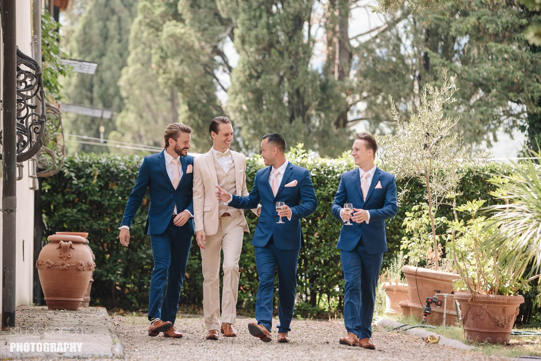 Groom with mens almost ready to leva for Vincigliata Castle