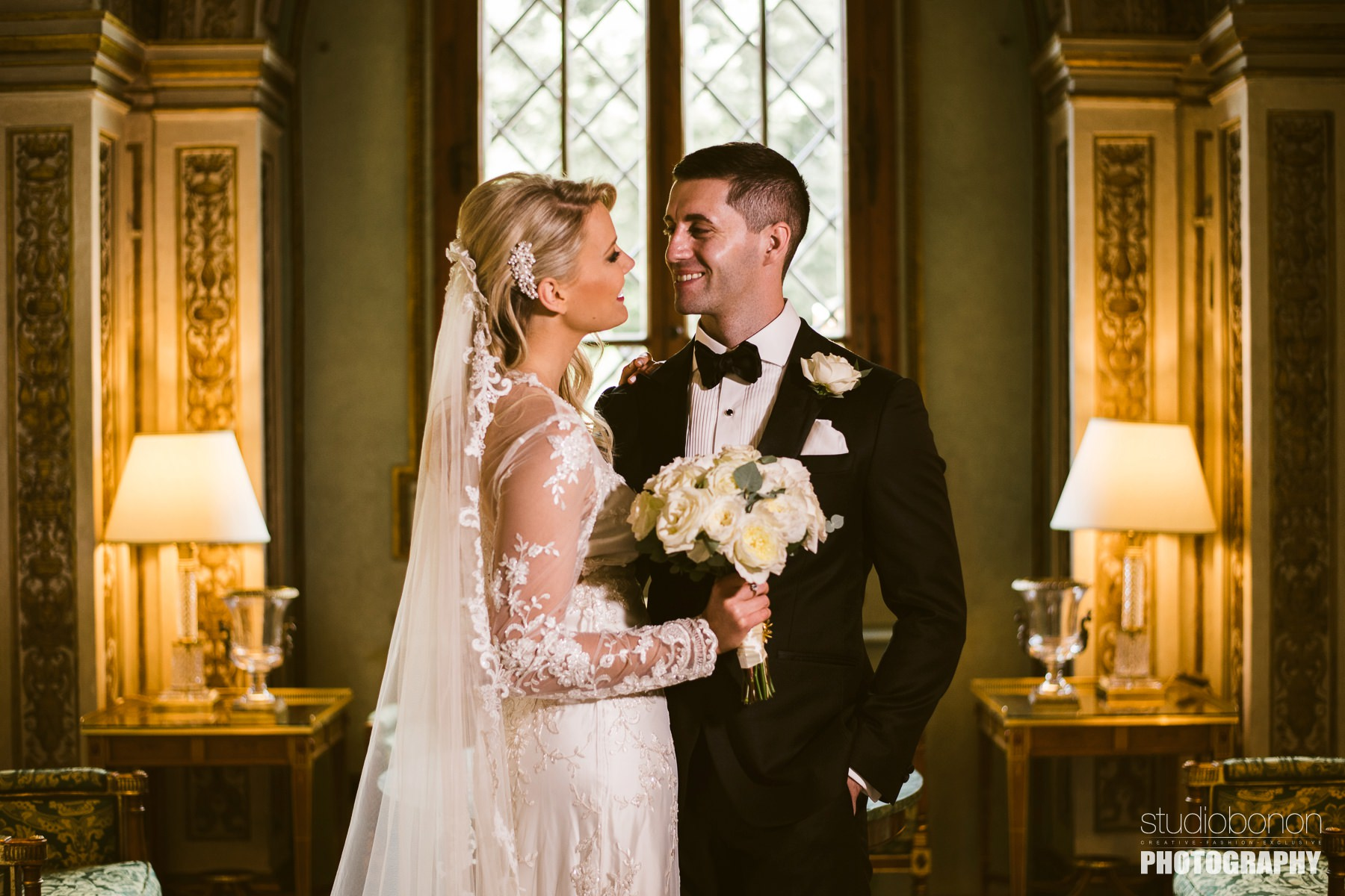 Lovely bride and groom portrait photo into the small chapel at Hotel Four Seasons Florence