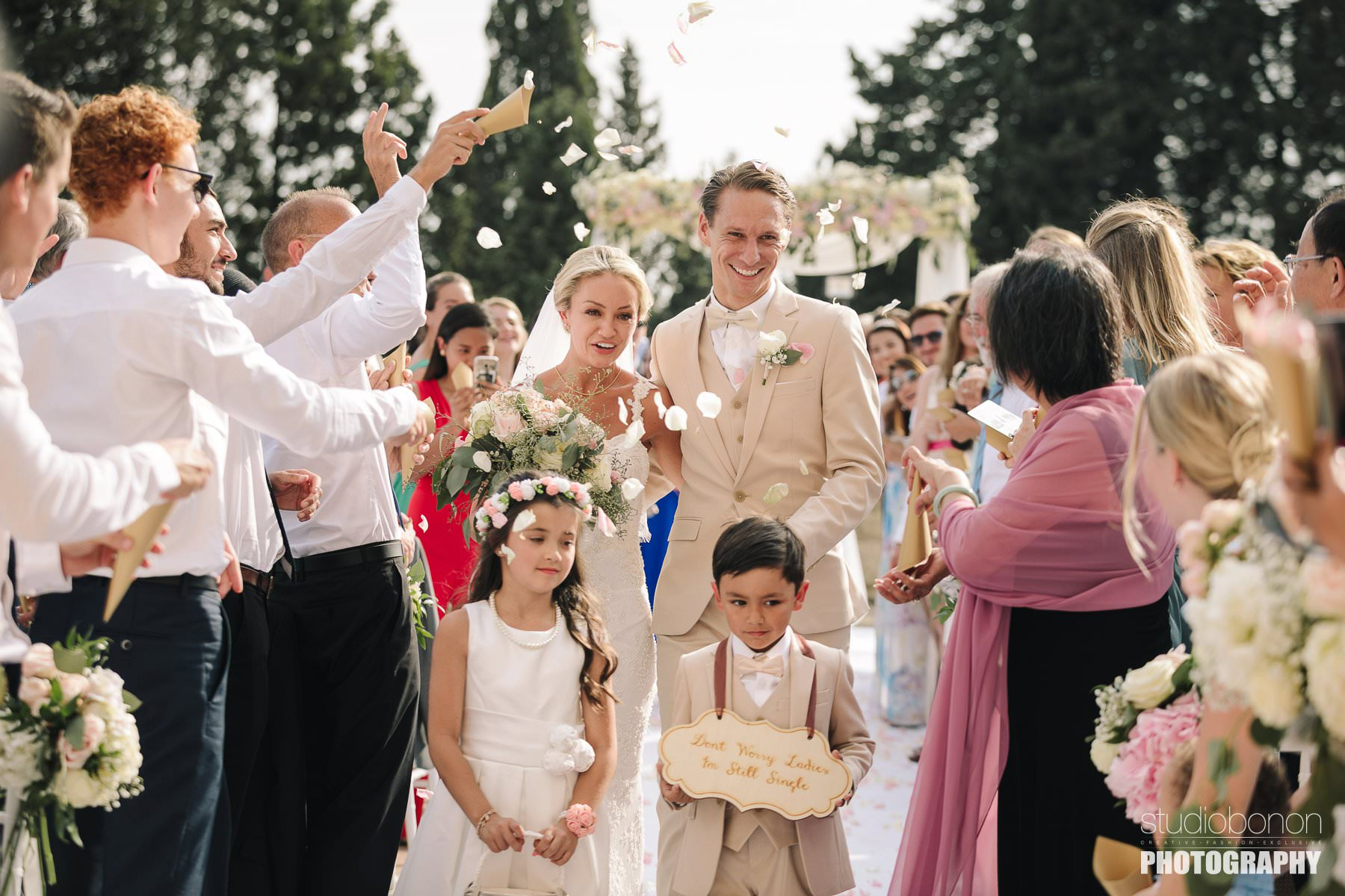 Petal throwing for bride and groom in this elegant and beautiful destination wedding in Tuscany countryside at Vincigliata Castle