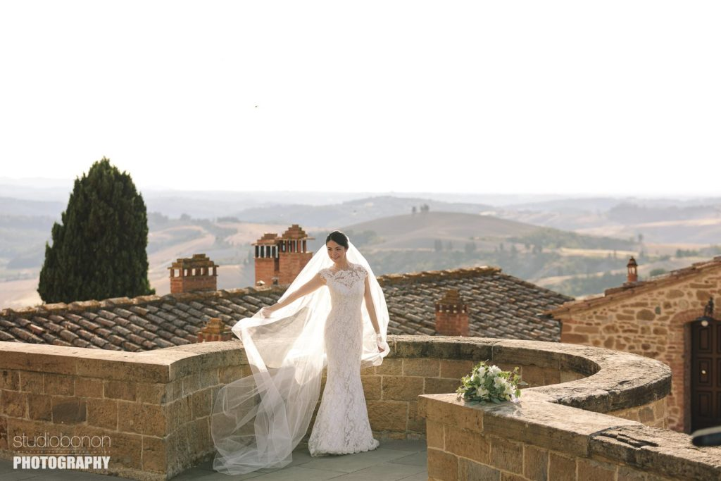 Bride groom share some love. Wedding portrait in Tuscany countryside at Tenuta di Castelfalfi