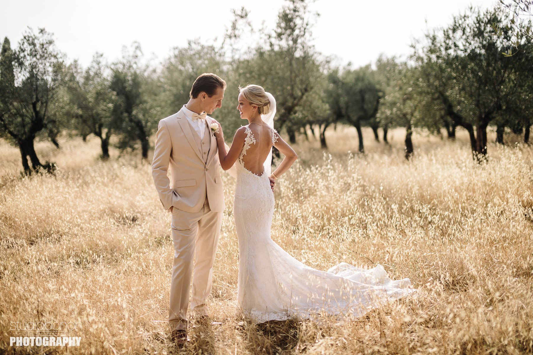 Lovely wedding photos in olive oil field at Vincigliata Castle, Florence countryside