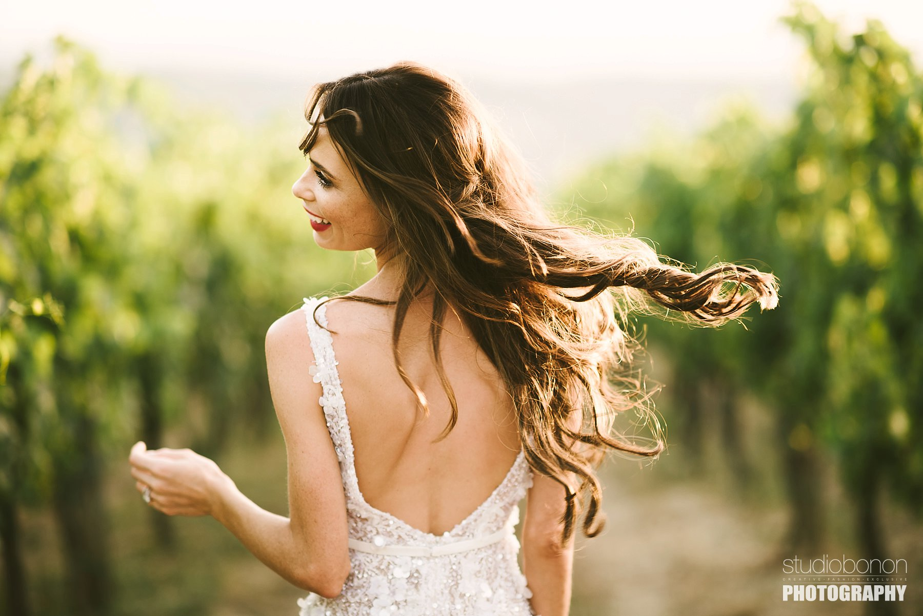 Beautiful bride Emily enjoy some lovely moment in a vineyard. Tuscany countryside destination wedding at Panzano in Chianti