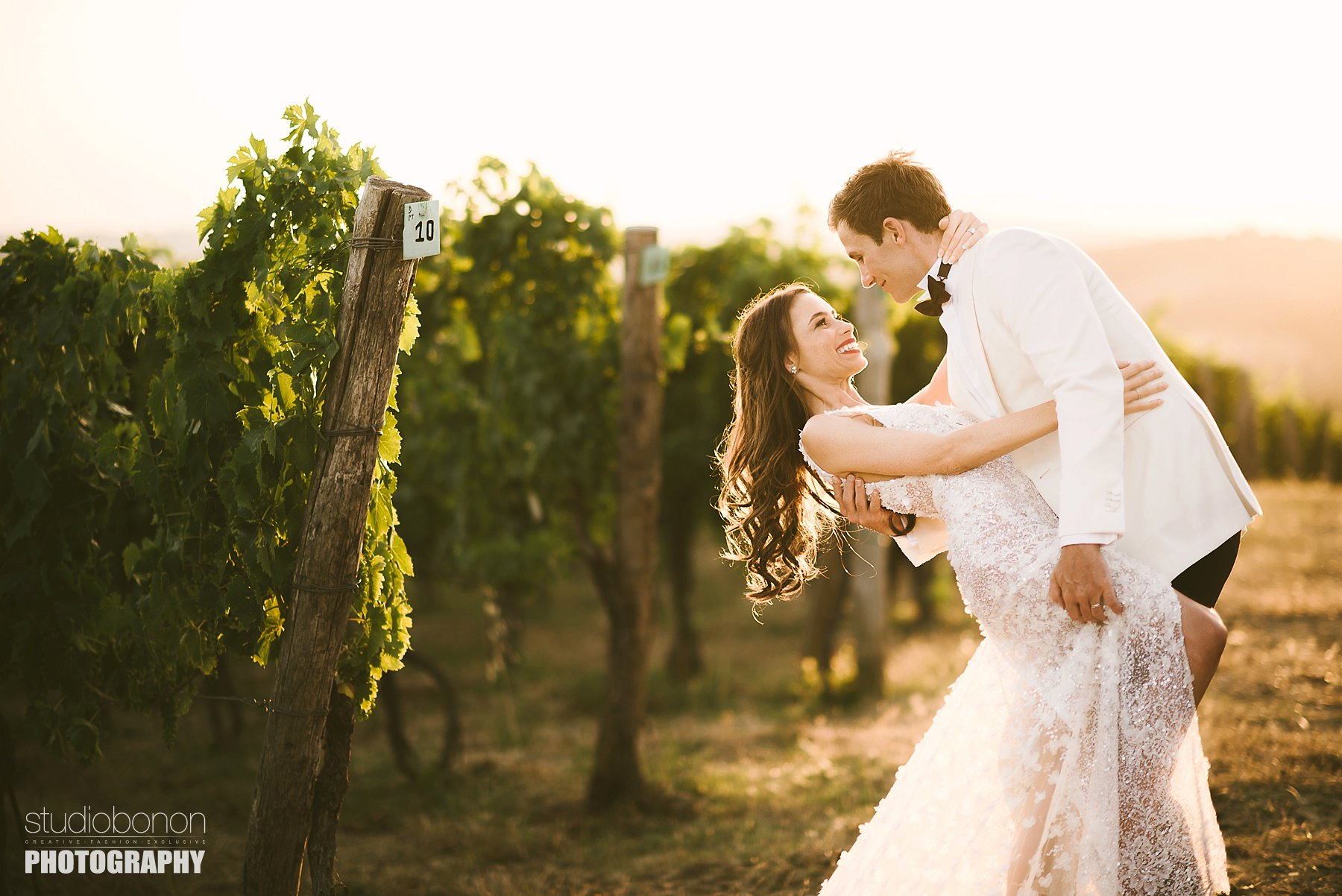 Unforgettable bride and groom portrait in a Tuscan vineyard near Panzano