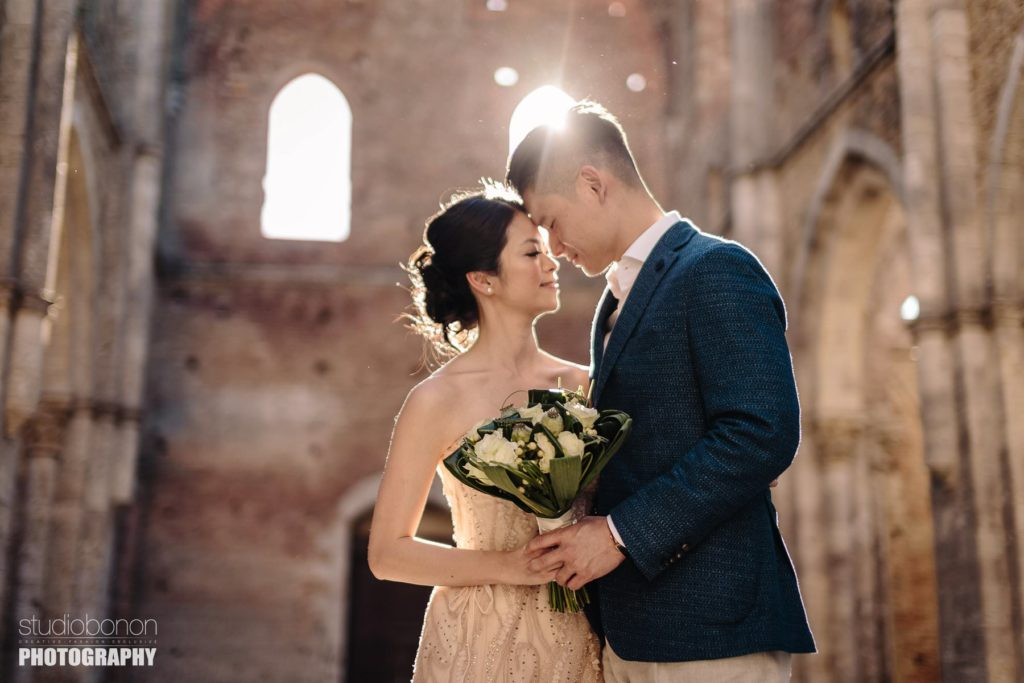 Lovely bride and groom portrait at San Galgano roofless abbey, Chiusdino Tuscany