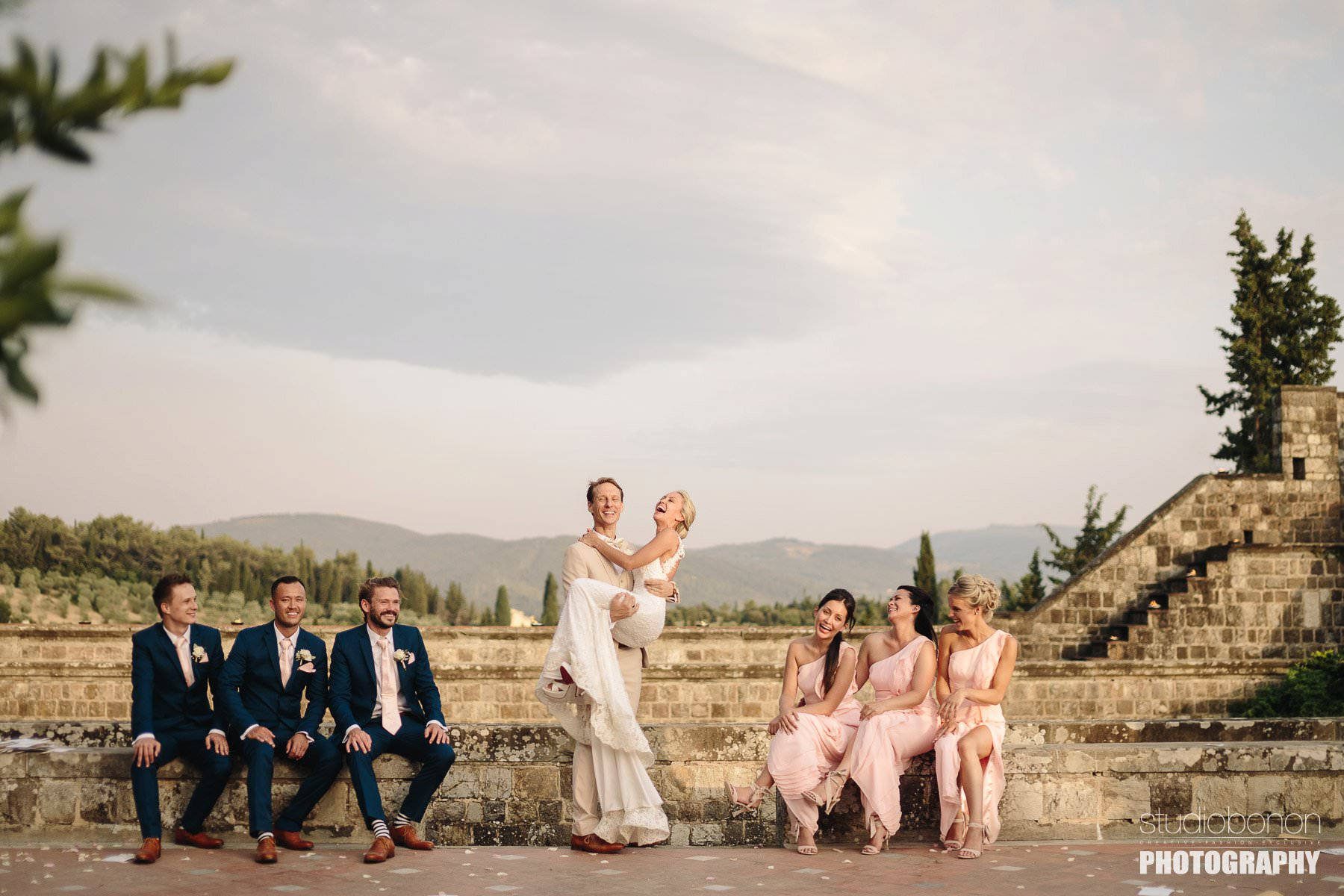 Lovely bridal party photo at Vincigliata castle into Florence countryside