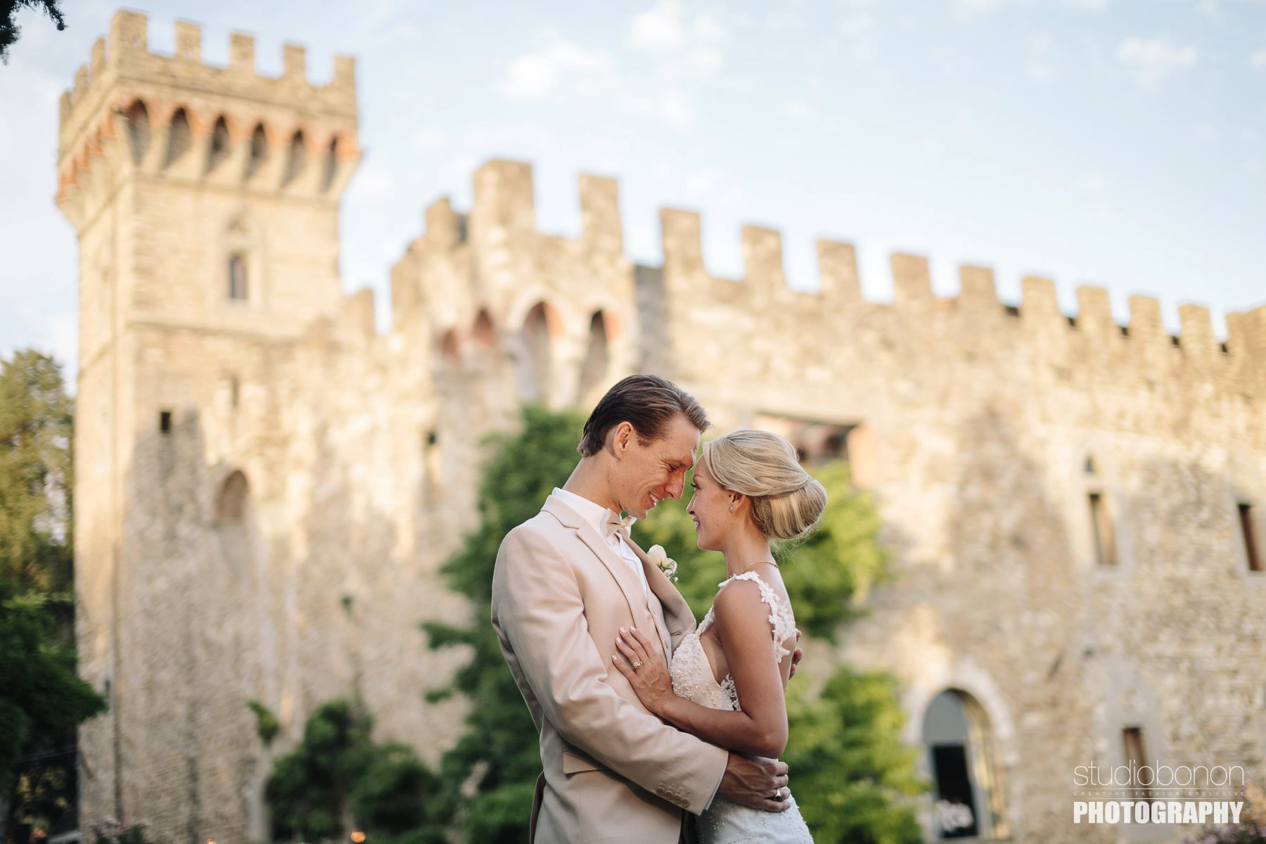 Castle destination wedding portrait Tuscany. Bride and groom are just married