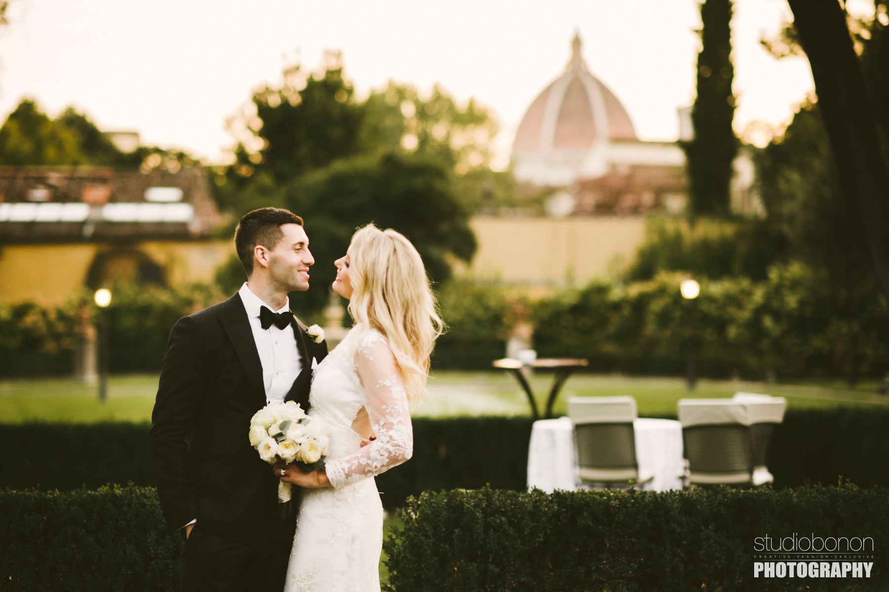 Elegant wedding photo with beautiful bride Amy and stunning groom Adrian with Florence Dome in the background