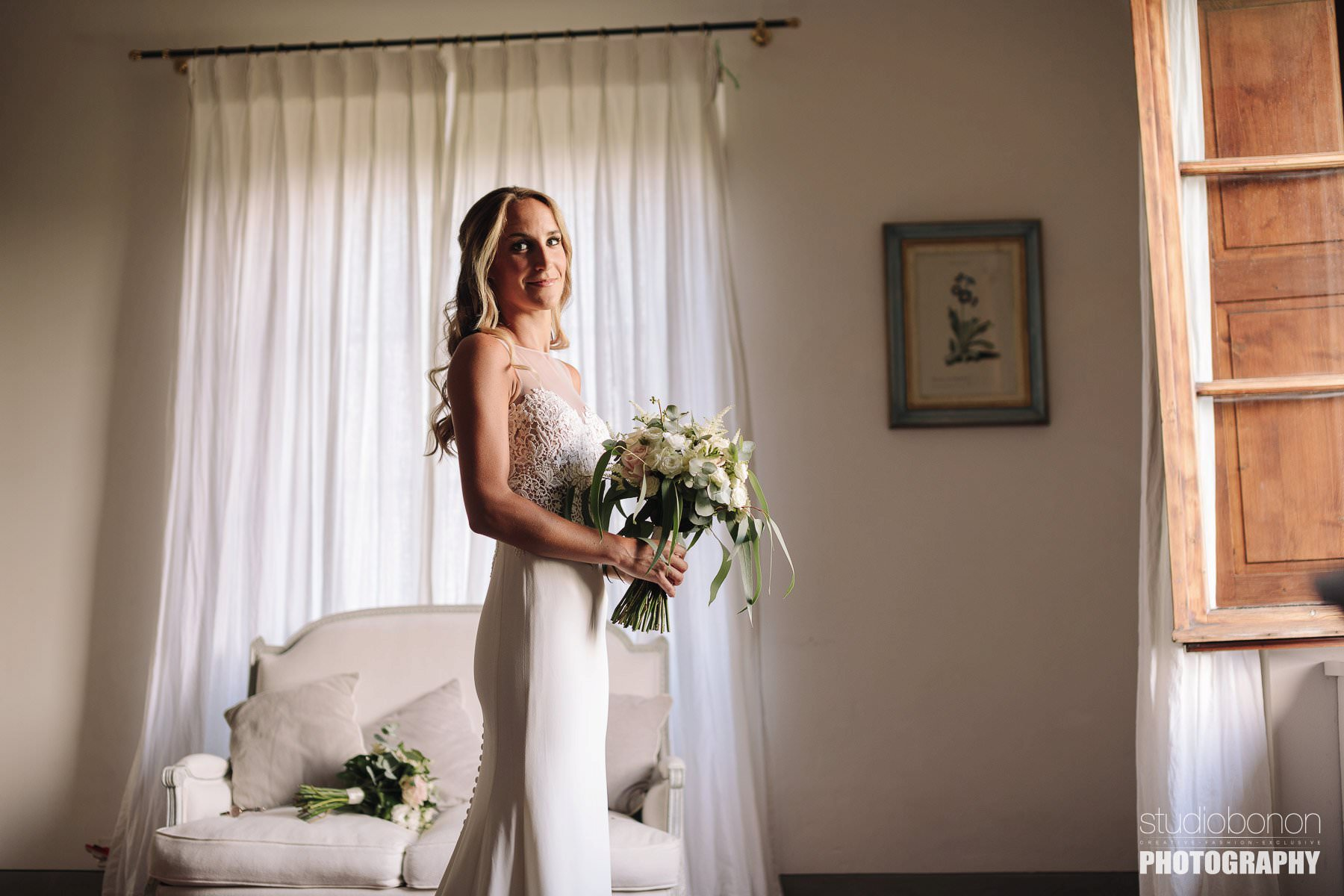 Beautiful bride in Tuscan Villa almost ready for wedding ceremony