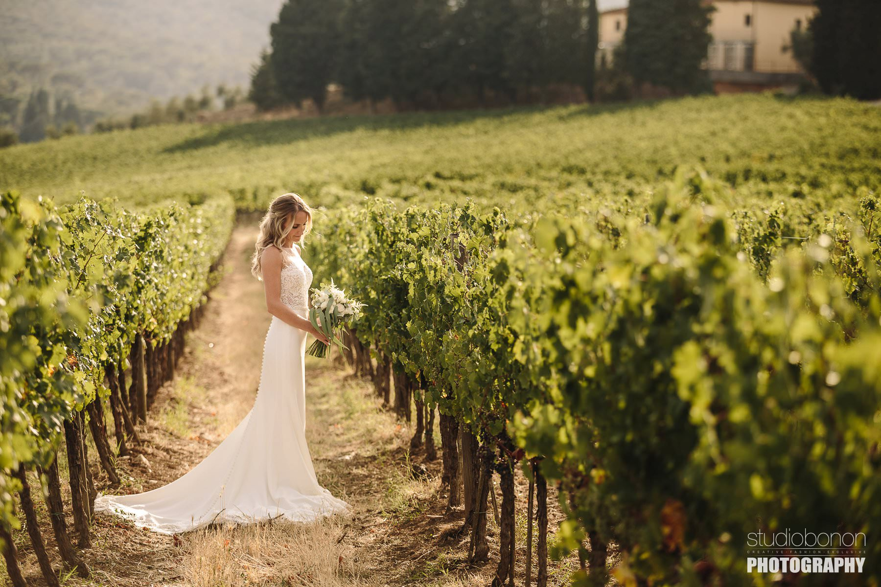 Beautiful bridal portrait into a Tuscan vineyard
