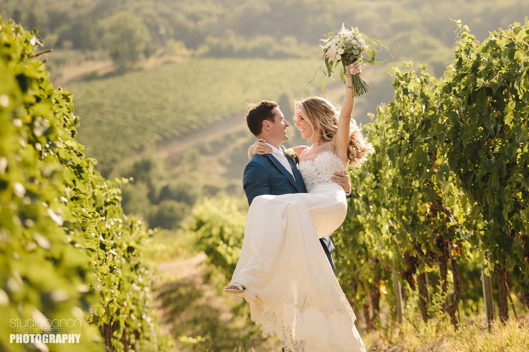 Bride and groom are sharing some lovely moment in a Tuscan vineyard into the countryside of Chianti near Villa Pisignano