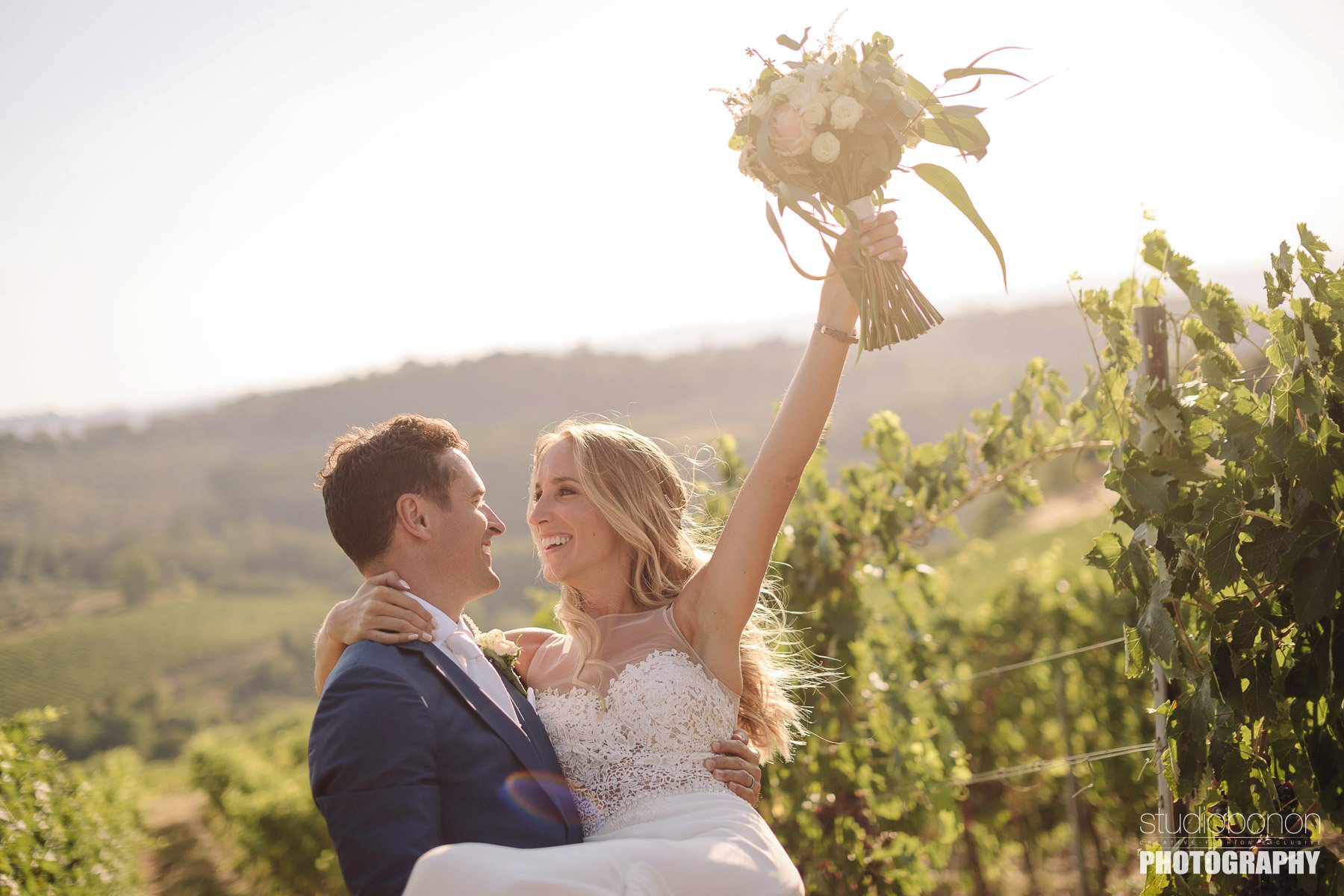 Bride and groom are sharing some lovely moment in a Tuscan vineyard into the countryside of Chianti