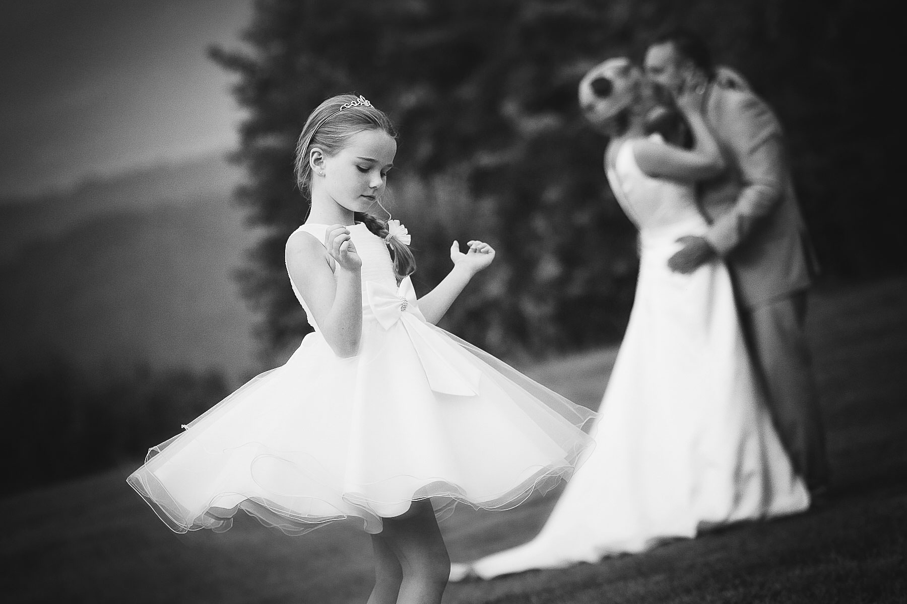 Elegant and lovely flower girl portrait during destination Tuscan Wedding near Florence